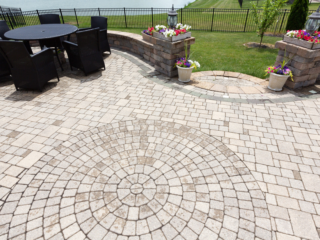Why choose patio pavers over stone or concrete slabs?